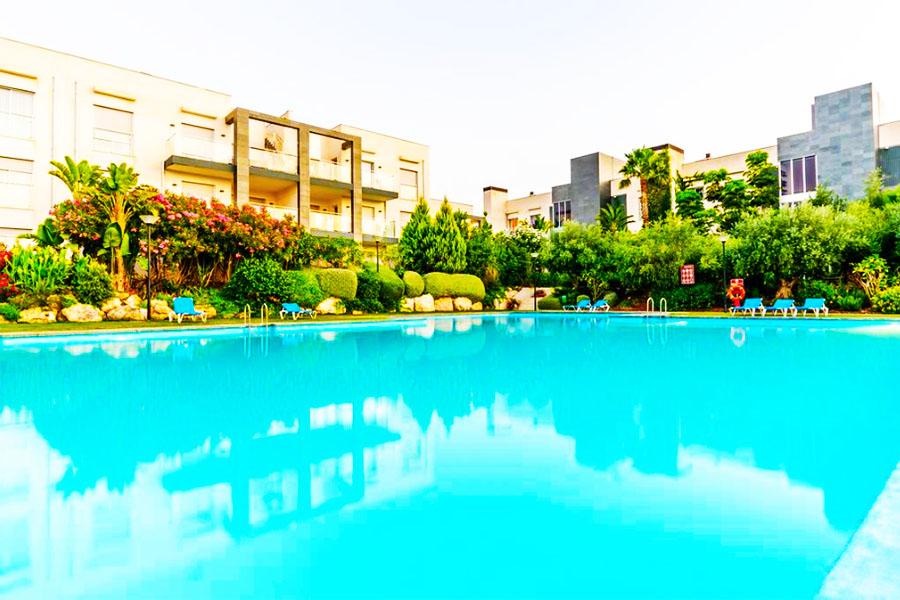 Piscina Hotel El Plantio Golf Resort